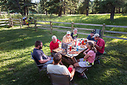 BC00636-00...MONTANA - Pizza night near Graves Creek along the Great Divide Route.