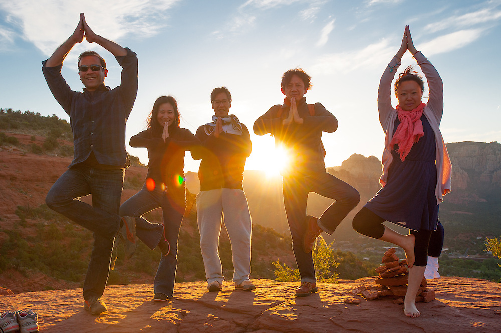 Group Doing Sunrise Yoga in Sedona AZ