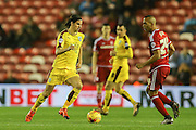 Burnley midfielder George Boyd  turns away from Middlesbrough midfielder Emilio Nsue  during the Sky Bet Championship match between Middlesbrough and Burnley at the Riverside Stadium, Middlesbrough, England on 15 December 2015. Photo by Simon Davies.