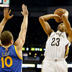 Nov 26, 2013; New Orleans, LA, USA; New Orleans Pelicans power forward Anthony Davis (23) shoots over Golden State Warriors power forward David Lee (10) during the first quarter of a game at New Orleans Arena. Mandatory Credit: Derick E. Hingle-USA TODAY Sports