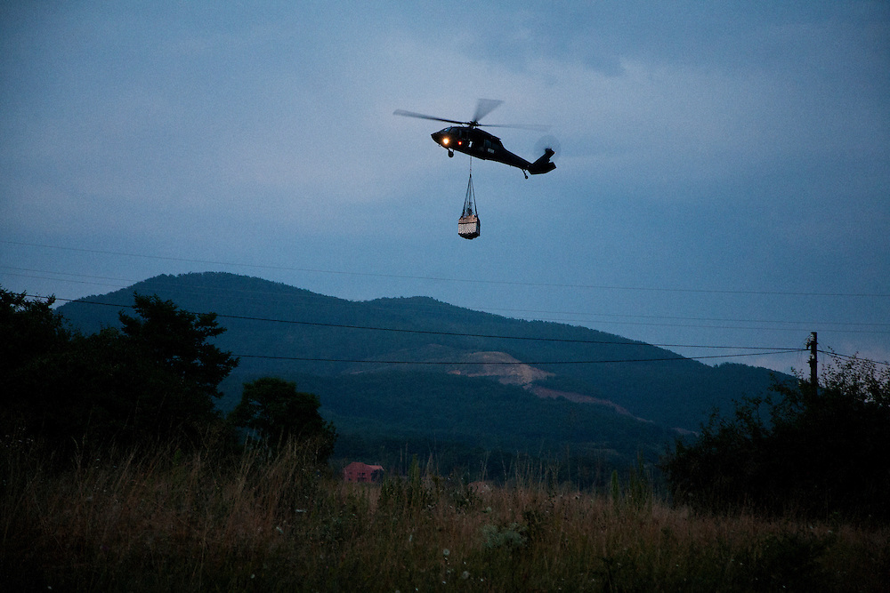 "A KFOR Blackhawk helicopter flies in supplies to the Jarinje checkpoint in Northern Kosovo during the Serbian blockade of the main supply route...KFOR-occupied ""Gate 1"" on the Serbian-Kosovo border, also known at Jarinje...Border crisis, July 2011"