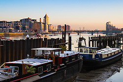 London, February 24th 2016. Houseboats rest on the river bank as the sun rises on a chilly but clear morning in London. &copy;Paul Davey<br /> FOR LICENCING CONTACT: Paul Davey +44 (0) 7966 016 296 paul@pauldaveycreative.co.uk