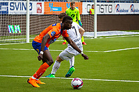 1. divisjon fotball 2018: Aalesund - Mjøndalen. Aalesunds Pape Gueye i duell med Ylldren Ibrahimaj (t.h.) i førstedivisjonskampen i fotball mellom Aalesund og Mjøndalen på Color Line Stadion.