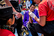 Many of the devotees dressed as Nazarenes complete the procession without shoes so as to be authentic in their portrayal. Medical teams line the procession route to deal with the countless injuries that result.