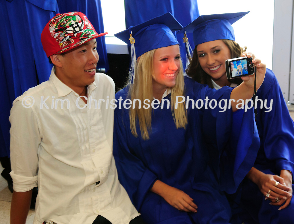Kohei Hamada, left Caity James and Kaylee Jordan pose for a photo at the Friendswood High School Graduation held at Moody Gardens.