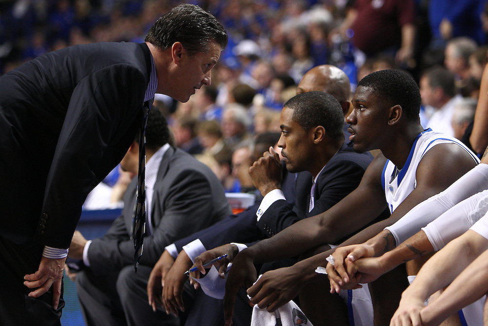 UK head coach John Calipari, left, talks with forward Alex Poythress after taking him out in the second half.The University of Kentucky Men's Basketball team hosted Texas A&M , Saturday, Jan. 12, 2013 at Rupp Arena in Lexington . Photo by Jonathan Palmer/Special to the Courier-Journal.