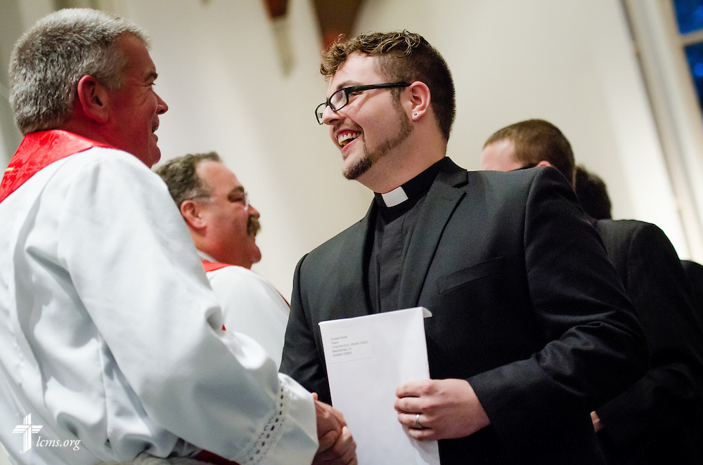 Andrew Rosse receives his call during an evening worship Tuesday, April 29, 2014, during 'call day' in the Chapel of St. Timothy and St. Titus at Concordia Seminary, St. Louis.  Greeting him is Concordia Seminary President Rev. Dr. Dale Meyer. LCMS Communications/Erik M. Lunsford