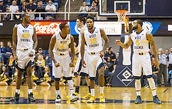 Jan 26, 2016; Morgantown, WV, USA; West Virginia Mountaineers players stand at mid court after two technical fouls were assessed during the first half against the Kansas State Wildcats at the WVU Coliseum. Mandatory Credit: Ben Queen-USA TODAY Sports