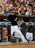Jun. 18 2011; Phoenix, AZ, USA; Arizona Diamondbacks infielder Ryan Roberts (14) reacts while playing against the Chicago White Sox at Chase Field. The White Sox defeated the Diamondbacks 6-2. Mandatory Credit: Jennifer Stewart-US PRESSWIRE.