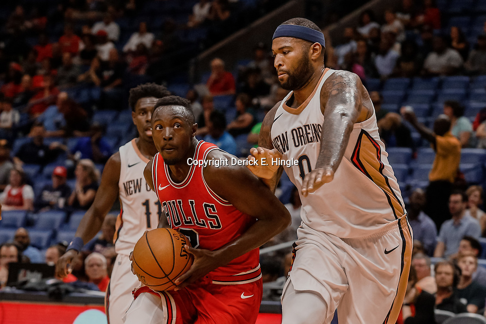 Oct 3, 2017; New Orleans, LA, USA; Chicago Bulls guard Jerian Grant (2) drives past New Orleans Pelicans forward DeMarcus Cousins (0) during the first half of a NBA preseason game at the Smoothie King Center. Mandatory Credit: Derick E. Hingle-USA TODAY Sports