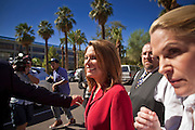 17 OCTOBER 2011 - PHOENIX, AZ:  MICHELE BACHMANN, a Republican candidate for US President, is guided to a waiting car after talking to members of the Arizona legislators at the State Capitol in Phoenix. Bachmann met with Republican Arizona legislators and Republican members of the state's Congressional delegation Monday morning to talk about illegal immigration and border security. During the meeting she pledged that if she were elected US President, she would construct a fence along the US - Mexico border.   PHOTO BY JACK KURTZ
