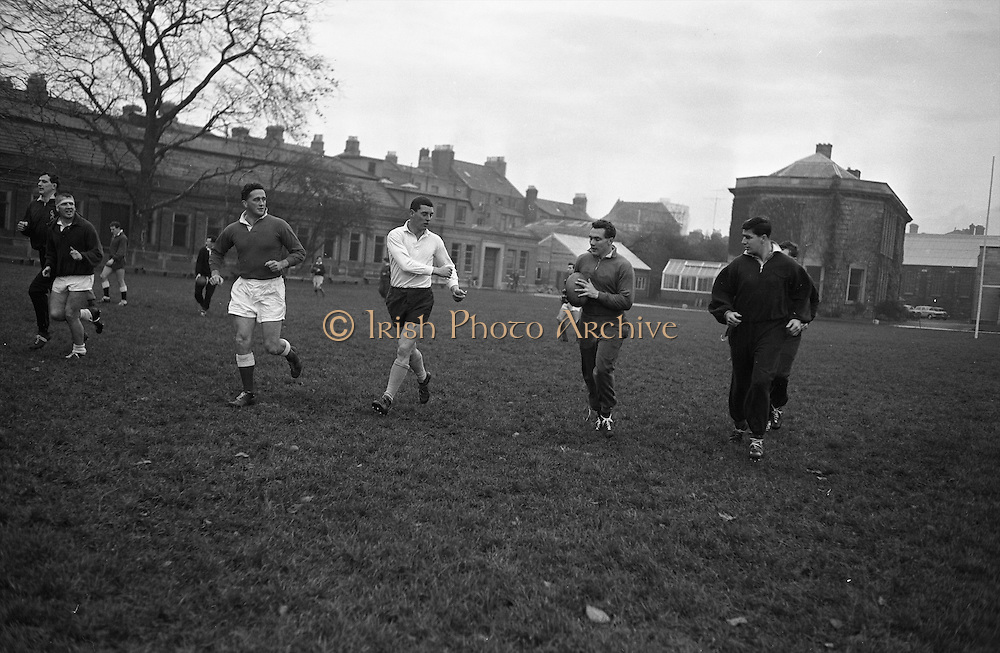 Irish Rugby Football Union, Ireland v Wales, Five Nations, Welsh team practice at J.C.P, Dublin, Ireland, Friday 16th November, 1962,.16.11.1962, 11.16.1962,..Welsh Team, ..G T R Hodgson, Wearing number 15 Welsh jersey, Full Back, Neath Rugby Football Club, Neath, Wales,..D Debb, Wearing number 11 Welsh jersey, Left Wing, Swansea Rugby Football Club, Swansea, Wales, ..D B Davies, Wearing number 12 Welsh jersey, Left centre, Llanelly Rugby Football Club, Llanelly, Wales, ..D K Jones, Wearing number 13 Welsh jersey, Right centre, Llanelly Rugby Football Club, Llanelly, Wales, ..D R R Morgan, Wearing number 14 Welsh jersey, Right wing, Llanelly Rugby Football Club, Llanelly, Wales, ..C Ashton, Wearing number 10 Welsh jersey, Stand Off, Aberavon Rugby Football Club, Port Talbot, Wales, ..A O'Connor, Wearing number 9 Welsh jersey, Scrum Half, Aberavon Rugby Football Club, Port Talbot, Wales, ..L J Cunningham, Wearing number 1 Welsh jersey, Forward, Aberavon Rugby Football Club, Port Talbot, Wales, ..B V Meredith, Wearing number 2 Welsh jersey, Captain of the Welsh team, Forward, Newport Rugby Football Club, Newport, Wales, ..J Warlow, Wearing number 3 Welsh jersey, Forward, Llanelly Rugby Football Club, Llanelly, Wales, ..W R Evans, Wearing number 4 Welsh jersey, Forward, Bridgend Rugby Football Club, Bridgend, South Wales,..K A Rowlands, Wearing number 5 Welsh jersey, Forward, Cardiff Rugby Football Club, Cardiff, Wales,..D J Davies, Wearing number 6 Welsh jersey, Forward, Neath Rugby Football Club, Neath, Wales,..A Pask, Wearing number 8 Welsh jersey, Forward, Abertillery Rugby Football Club, Gwent, South Wales,..H J Morgan, Wearing number 7 Welsh jersey, Forward, Abertillery Rugby Football Club, Gwent, South Wales,.