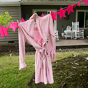 A pink robe hangs on a clothesline by a resident along the Red Course during the annual Pink Ball Tournament in Charbonneau.<br /> Photo by Jaime Valdez