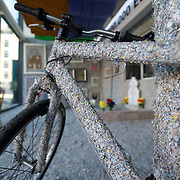 March 27, 2012 - Dublin, Ireland: A bicycle covered with shredded money is on display at the Billion Euro House art installation by the Irish artist Frank Buckley. ..Worthless euros, taken out of circulation and shredded by Irelands Central Bank, formes the interior walls of an apartment that Mr. Buckley does not own in a building left vacant by the countrys economic ruin...The artist decided to call the apartment  built from thousands of bricks of shredded, decommissioned cash (each brick contains, roughly, what used to be 50,000 euros)  the Billion Euro House. He reckons that about 1.4 billion euros actually went into it, but the joke, of course, is that it is worth simultaneously so much and so little...A large gravestone beside the main door, announces that Irish sovereignty died in 2010, the year that the government accepted an international bailout so larded with onerous conditions that the Irish will be paying for it for years to come. (Paulo Nunes dos Santos/Polaris)