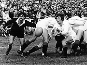 Captain Lyn Davis clears the ball in front of his opposite Dave Loveridge (left) during All Blacks trials at Wanganui on 14 May 1977.<br /> Copyright photo: Ron Cooke / www.photosport.nz