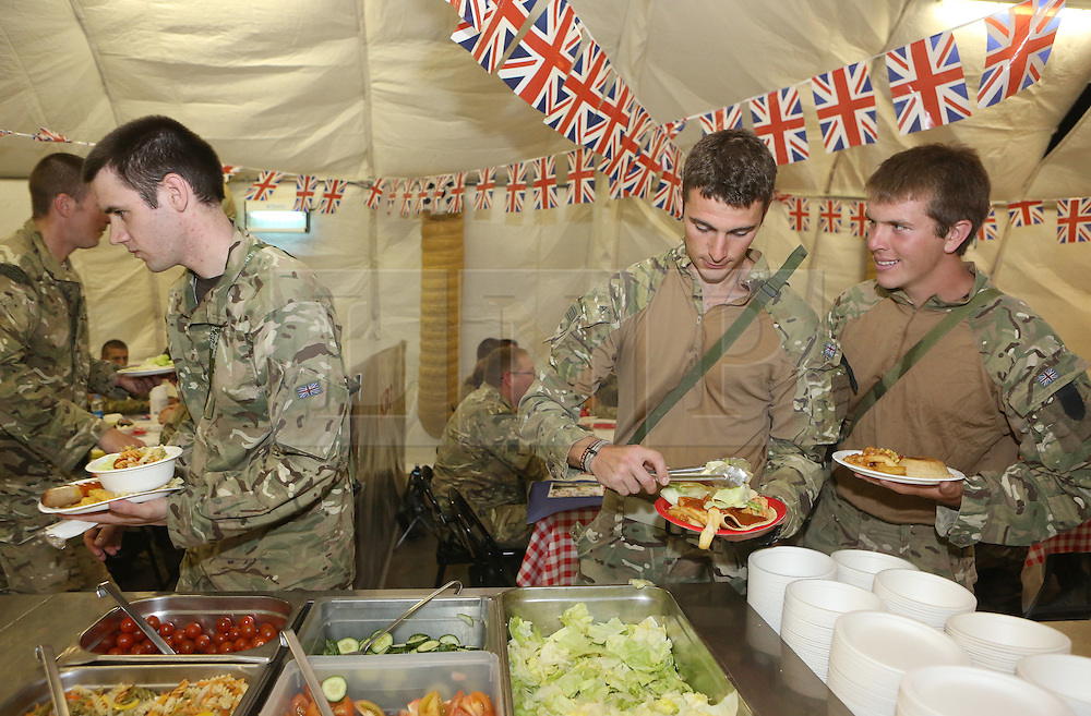 © Licensed to London News Pictures. 29/05/2012, Camp Bastion, Afghanistan. Soldiers celebrate the Queens Jubilee in Afghanistan by decorating their food hall with Union Jack bunting.  The men and women of the Armed Forces will be working through the weekend as thousands celebrate back home in the UK.   Photo credit : Alison Baskerville/LNP