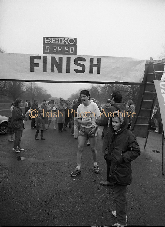 First All-Traveller Mini Marathon.    (R53)..1987..05.04.1987..04.05.1987..5th April 1987..Today saw the running of the first All-Traveller Mini Marathon in aid of Trocaire the World Aid Agency. The race was run over a 10k course in the Phoenix Park, Dublin. Bishop Eamon Casey a patron of the charity was on hand to lend support...Michael Cullen, from Finglas, Dublin, in the mini marathon. crossing the finishing line in first place