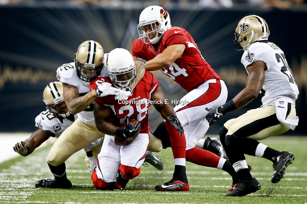 Sep 22, 2013; New Orleans, LA, USA; Arizona Cardinals running back Rashard Mendenhall (28) is tackled by New Orleans Saints strong safety Kenny Vaccaro (32) during a game at Mercedes-Benz Superdome. The Saints defeated the Cardinals 31-7. Mandatory Credit: Derick E. Hingle-USA TODAY Sports