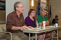 """Bob Manley of Hermit Woods Winery; Sarah Gray of Body Covers and Allan Beetle of Patrick's Pub & Eatery speak during the """"lunch with local entrepreneurs"""" at Wednesday's Business Resource Fair held in Woodside at the Taylor Home Community.  (Karen Bobotas/for the Laconia Daily Sun)"""