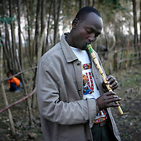 An Ethiopian man plays a flute during a 24 hours journey of a group of 46 Falash Mura people from Gondar to Addis Ababa in order to immigrate to Israel, May 2008.