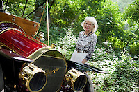"9 July, 2008. Doylestow, PA. Patricia Grundy, mother of Jim Grundy, is in front of the 1909 Pierce Arrow antique car her son owns. Patricia Grundy sat in the back seat of this car at the age of 16, when her parents drove from Philadelphia to Detroit to participate at the Glidden Tour. Jim Grundy, 54, is the chief executor of Grundy Worldwide, an insurance company for collectible cars. His father Jim Sr. Jr.  started the business in 1947 and wrote the first antique car insurance policy in 1949. Jim Grundy has been in the business for 28 years and assumed major interest and the presidency 19 years ago. ""I own the best pre World War I cars ever manufactured"", Mr. Grundy says. <br /> <br /> ©2008 Gianni Cipriano for The Wall Street Journal<br /> cell. +1 646 465 2168 (USA)<br /> cell. +1 328 567 7923 (Italy)<br /> gianni@giannicipriano.com<br /> www.giannicipriano.com"