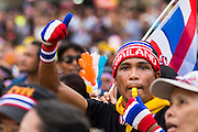 "15 NOVEMBER 2013 - BANGKOK, THAILAND: An anti-government protester blows a whistle and gives a thumbs up to protest leaders in Bangkok. Tens of thousands of Thais packed the area around Democracy Monument in the old part of Bangkok Friday night to protest against efforts by the ruling Pheu Thai party to pass an amnesty bill that could lead to the return of former Prime Minister Thaksin Shinawatra. Protest leader and former Deputy Prime Minister Suthep Thaugsuban announced an all-out drive to eradicate the ""Thaksin regime."" The protest Friday was the biggest since the amnesty bill issue percolated back into the public consciousness. The anti-government protesters have vowed to continue their protests even though the Thai Senate voted down the bill, thus killing it for at least six months.     PHOTO BY JACK KURTZ"