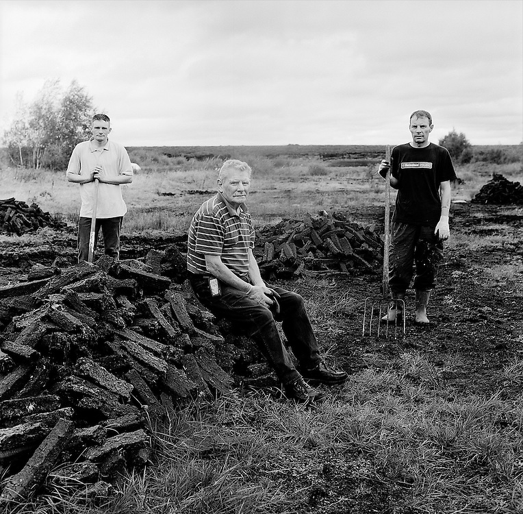 Tom Higgins with his sons  Brian (L) and Michael (R) on their turf bank at Mouds bog in Co. Kildare. Photo: Kim Haughton