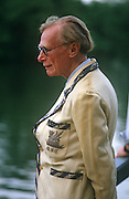 An elderly gentlemen member of an unknown rowing and sculling club at the annual Henley-on-Thames boating festival.