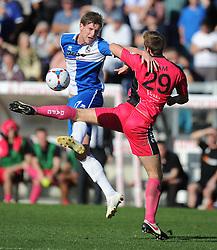 Bristol Rovers' Adam Cunnington wins a high ball over Dover Athletic's Connor Essam - Photo mandatory by-line: Alex James/JMP - Mobile: 07966 386802 - 04/10/2014 - SPORT - Football - Bristol - Memorial Stadium - Bristol Rovers v Dover - Vanarama Football Conference