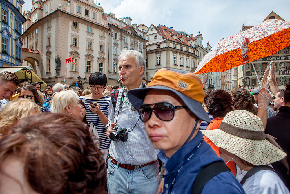Tourist groups and visitors at Old Town Square in Prague. One of the main attractions on the square is The Prague astronomical clock, or Prague orloj (Czech: Pražský orloj) which is a medieval astronomical clock. The clock was first installed in 1410, making it the third-oldest astronomical clock in the world and the oldest one still operating.