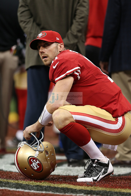 Alex Smith (11) of the San Francisco 49ers looks on against the Baltimore Ravens during the NFL Super Bowl XLVII football game in New Orleans on Feb. 3, 2013. The Ravens won the game, 34-31.  (Photo by Jed Jacobsohn)