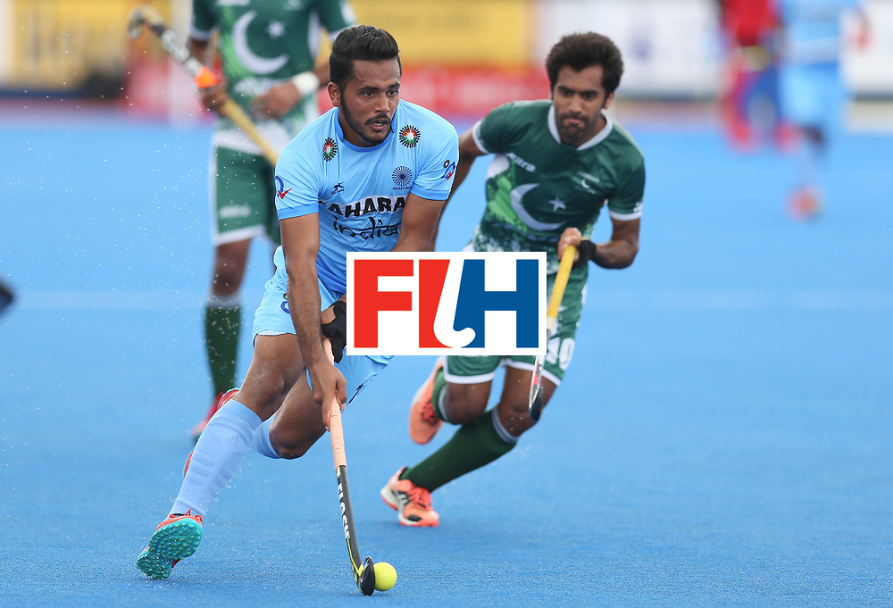 LONDON, ENGLAND - JUNE 24: Harmanpreet Singh of India runs with the ball during the 5th-8th place match between Pakistan and India on day eight of the Hero Hockey World League Semi-Final at Lee Valley Hockey and Tennis Centre on June 24, 2017 in London, England. (Photo by Steve Bardens/Getty Images)