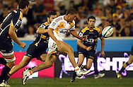 Tawera Kerr-Barlow kicks ahead to regather and score.Super 14 rugby union match, Brumbies v Cheifs, Canberra, Australia. Saturday 19 February 2011. Photo: Paul Seiser/PHOTOSPORT.../SPORTZPICS