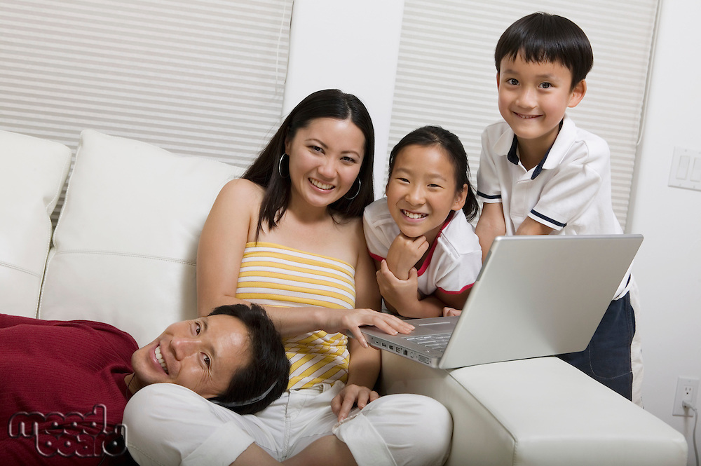Family on Couch Using Laptop