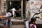children at play in the back alleys of the old city of lahore