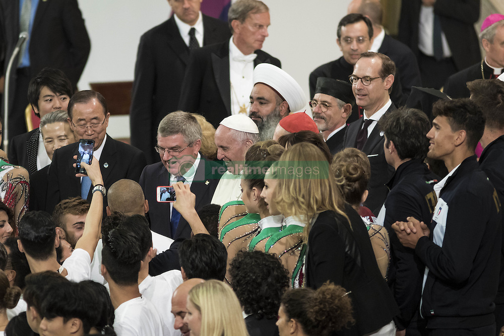 October 5, 2016 - Vatican City, Vatican - U.N. Secretary General Ban Ki-moon, International Olympic Committee President Thomas Bach and Pope Francis poses for a photo during the International conference ''Sport at the Service of Humanity'', the first global conference on faith and sport promoted by the Vatican Pontifical Council for Culture, in the Paul VI hall in Vatican City, Vatican on October 05, 2016. (Credit Image: © Giuseppe Ciccia/Pacific Press via ZUMA Wire)