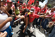 Supporters of Hugo Chavez celebrating the sixth anniversary of the failed coup against Chavez in the historic Center of Caracas. Chavistas dancing to hot tropical rythms.