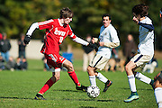 CVU's Cooper O'Connell (10) runs down the field with the ball during the boys soccer game between the Champlain Valley Union Redhawks and the Essex Hornets at Essex High School on Saturday mooring October 10, 2015 in Essex. (BRIAN JENKINS/For the FREE PRESS)