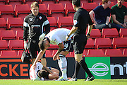 Bolton Wanderers forward Gary Madine (14) seeing if Bolton Wanderers midfielder Mark Davies (16) is ok before Bolton Wanderers midfielder Mark Davies (16) went off injured during the EFL Sky Bet Championship match between Charlton Athletic and Bolton Wanderers at The Valley, London, England on 27 August 2016. Photo by Matthew Redman.