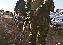 December 4, 2016 - Mosul, Iraq - A boy waits with family to enter the Hassan Sham 3 Camp as he joins thousands of other Internally Displaced People fleeing ISIS from Mosul as Iraqi Security Forces move to clear the city of the terror network, in the Kurdistan Region. (Credit Image: © ZUMA Wire via ZUMA Wire)