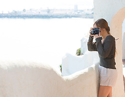 Woman Taking a Photograph Outdoors