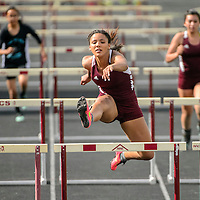042915  Adron Gardner/Independent<br /> <br /> Ramah Mustang Taea Hill clears the final hurdle in first place during the district 1-2A track meet in Ramah Friday.