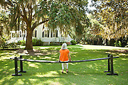 A women on a joggling board at Hopsewee Plantation mansion in Georgetown, SC.