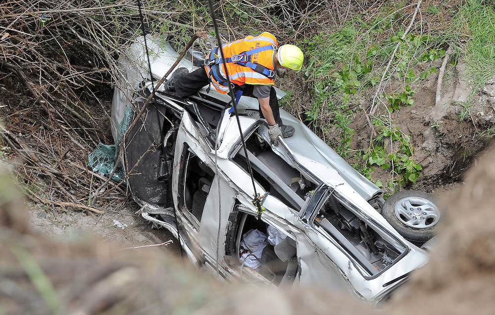 Police recover the vehicle after six people were seriously injured including a six month old child after a van crashed off SH5 between Napier and Taupo near Te Haroto, Napier, New Zealand, Thursday, January 02, 2014. Credit: SNPA / Kerry Marshall