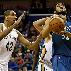 Feb 27, 2016; New Orleans, LA, USA; Minnesota Timberwolves center Karl-Anthony Towns (32) is defended by New Orleans Pelicans center Alexis Ajinca (42) during the first half of a game at  the Smoothie King Center. Mandatory Credit: Derick E. Hingle-USA TODAY Sports