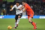 Derby County midfielder Duane Holmes and Millwall defender Murray Wallace challenge for the ball during the EFL Sky Bet Championship match between Derby County and Millwall at the Pride Park, Derby, England on 20 February 2019.