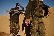 Iraqi army soldiers take a smoke break during a mission, Iraq, Jan, 23, 2007.