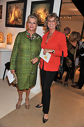 Left to right, LUCIANA REVI and BARONESS MARIE-CLAIRE VON ALVENSLEBEN at a preview evening of the annual London LAPADA (The Association of Art & Antiques Dealers) antiques Fair held in Berkeley Square, London on 20th September 2011.