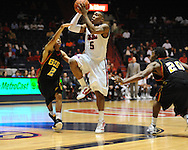 "Ole Miss' Dundreceous Nelson (5) drives through Grambling State's Rondale Livas (2) and Roman Higgins (20) during the first half at the C.M. ""Tad"" Smith Coliseum in Oxford, Miss. on Monday, November 14, 2011.."