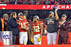 Jan 19, 2020; Kansas City, Missouri, USA; Kansas City Chiefs tight end Travis Kelce (87), Kansas City Chiefs strong safety Tyrann Mathieu (32) and quarterback Patrick Mahomes (15) celebrates with the Lamar Hunt Trophy after beating the Tennessee Titans in the AFC Championship Game at Arrowhead Stadium. Mandatory Credit: Denny Medley-USA TODAY Sports